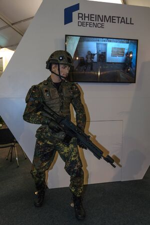 german soldier: BERLIN, GERMANY - JUNE 01, 2016: The stand of Rheinmetall Defence. Modern equipment a soldier of the German army (Bundeswehr). Exhibition ILA Berlin Air Show 2016.