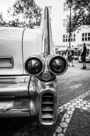 car brake: BERLIN - JUNE 05, 2016: The rear brake lights of full-size luxury car Cadillac Fleetwood Series 70 Eldorado Brougham, 1957. Black and white. Classic Days Berlin 2016. Editorial