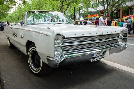 fury: BERLIN - JUNE 05, 2016: Full-size car Plymouth Fury III Convertible, 1968. Classic Days Berlin 2016.