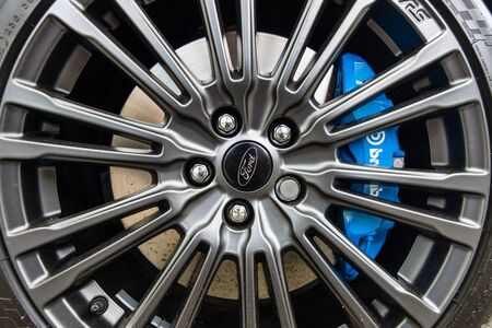 third wheel: BERLIN - JUNE 05, 2016: The brake system and wheel of compact car Ford Focus RS (third generation), close-up. Classic Days Berlin 2016.