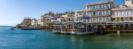 elite: CRETE, GREECE - JULY 11, 2016: Panoramic view of the embankment of a small elite tourist town - Elounda, municipality of Agios Nikolaos.