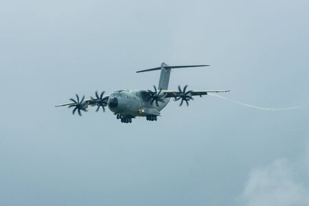 turboprop: BERLIN, GERMANY - JUNE 01, 2016: Demonstration flight at rainy day of the military transport aircraft Airbus A400M Atlas. Exhibition ILA Berlin Air Show 2016