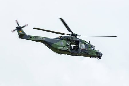 BERLIN, GERMANY - JUNE 01, 2016: Helicopter NH90 of the German Army. Demonstrative performance. Exhibition ILA Berlin Air Show 2016