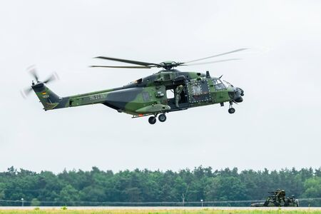BERLIN, GERMANY - JUNE 01, 2016: Landing helicopter NH90 of the German Army. Demonstrative performance. Exhibition ILA Berlin Air Show 2016