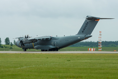 turboprop: BERLIN, GERMANY - JUNE 01, 2016: Preparing for takeoff military transport aircraft Airbus A400M Atlas. Exhibition ILA Berlin Air Show 2016