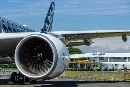 newest: BERLIN, GERMANY - JUNE 01, 2016: Turbofan engine of the newest airplane Airbus A350-900 XWB. Exhibition ILA Berlin Air Show 2016