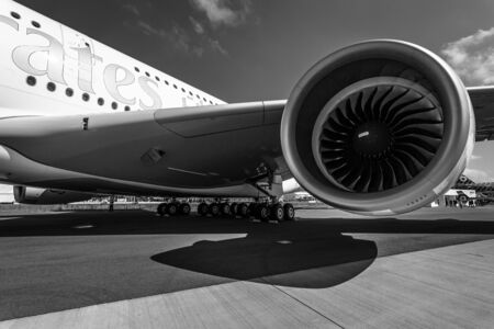 turbofan: BERLIN, GERMANY - JUNE 01, 2016: Detail of the wing and a turbofan engine Engine Alliance GP7000 of the largest aircraft in the world - Airbus A380. Emirates Airline. Black and white. Exhibition ILA Berlin Air Show 2016 Editorial