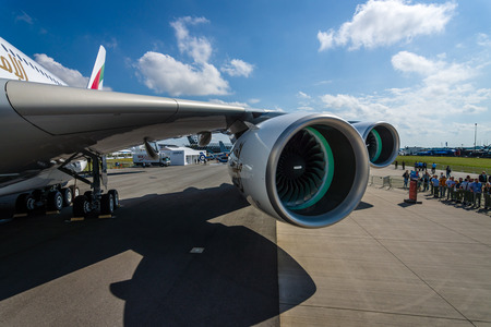 turbofan: BERLIN, GERMANY - JUNE 01, 2016: Detail of the wing and a turbofan engine Engine Alliance GP7000 of the largest aircraft in the world - Airbus A380. Emirates Airline. Exhibition ILA Berlin Air Show 2016