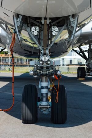 newest: BERLIN, GERMANY - JUNE 02, 2016: Front landing gear of the newest airplane Airbus A350-900 XWB. Exhibition ILA Berlin Air Show 2016