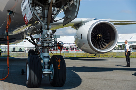 turbofan: BERLIN, GERMANY - JUNE 02, 2016: Front landing gear and turbofan Rolls-Royce Trend 900 of the newest airplane Airbus A350-900 XWB. Exhibition ILA Berlin Air Show 2016 Editorial