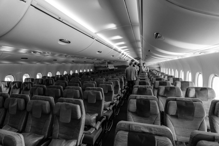 black economy: BERLIN, GERMANY - JUNE 02, 2016: Interior of an economy class of the worlds largest aircraft Airbus A380. Emirates Airline. Black and white. Exhibition ILA Berlin Air Show 2016 Editorial