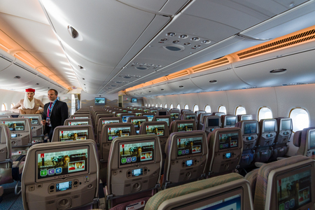 BERLIN, GERMANY - JUNE 02, 2016: Interior of an economy class of the worlds largest aircraft Airbus A380. Emirates Airline. Exhibition ILA Berlin Air Show 2016