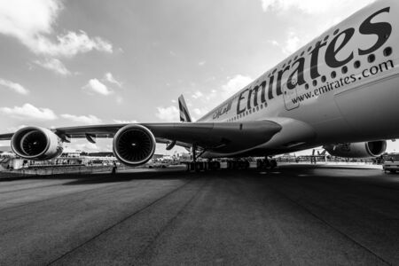 turbofan: BERLIN, GERMANY - JUNE 02, 2016: Detail of the wing and a turbofan Engine Alliance GP7000 of the airliner - Airbus A380. Emirates Airline. Black and white. Exhibition ILA Berlin Air Show 2016