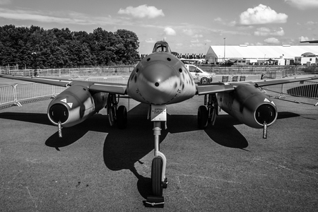 modern fighter: BERLIN, GERMANY - JUNE 02, 2016: Fighter aircraft Messerschmitt Me 262 B-1a Schwalbe. Modern replica by Airbus Group. Black and white. Exhibition ILA Berlin Air Show 2016
