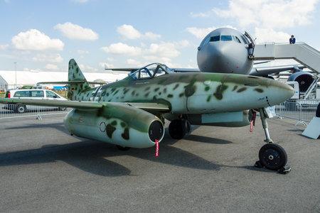 modern fighter: BERLIN, GERMANY - JUNE 02, 2016: Fighter aircraft Messerschmitt Me 262 B-1a Schwalbe. Modern replica by Airbus Group. Exhibition ILA Berlin Air Show 2016 Editorial
