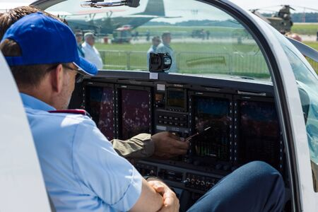 turboprop: BERLIN, GERMANY - JUNE 02, 2016: The dashboard and avionics Genesys Aerosystems of two-seat turboprop training and aerobatic low-wing aircraft Grob G120TP. Exhibition ILA Berlin Air Show 2016
