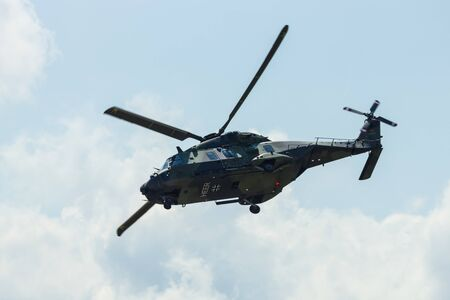 demonstrative: BERLIN, GERMANY - JUNE 02, 2016: Helicopter NH90 of the German Army. Demonstrative performance. Exhibition ILA Berlin Air Show 2016 Editorial