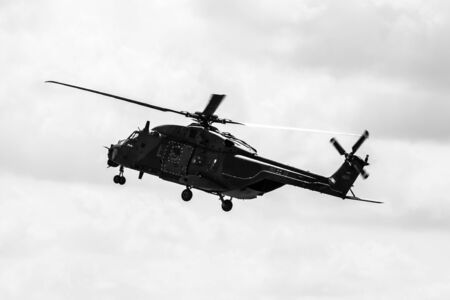 demonstrative: BERLIN, GERMANY - JUNE 02, 2016: Helicopter NH90 of the German Army. Demonstrative performance. Black and white. Exhibition ILA Berlin Air Show 2016