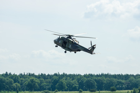 BERLIN, GERMANY - JUNE 02, 2016: Helicopter NH90 of the German Army. Demonstrative performance. Exhibition ILA Berlin Air Show 2016 Redakční
