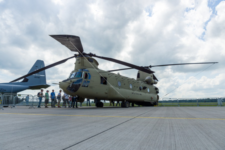 BERLIN, GERMANY - JUNE 02, 2016: The twin-engine, tandem rotor heavy-lift helicopter Boeing CH-47 Chinook. US Army. Exhibition ILA Berlin Air Show 2016