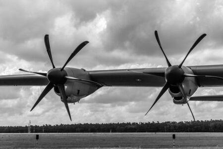 us air force: BERLIN, GERMANY - JUNE 02, 2016: Detail of the turboprop military transport aircraft Lockheed Martin C-130J Super Hercules. US Air Force. Black and white. Exhibition ILA Berlin Air Show 2016