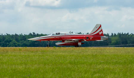 BERLIN, GERMANY - JUNI 02, 2016: Landing of jet Northrop F-5E Tiger II. The aerobatic team Patrouille Suisse. The pilot, Captain S.Billeter. Exhibition ILA Berlin Air Show 2016