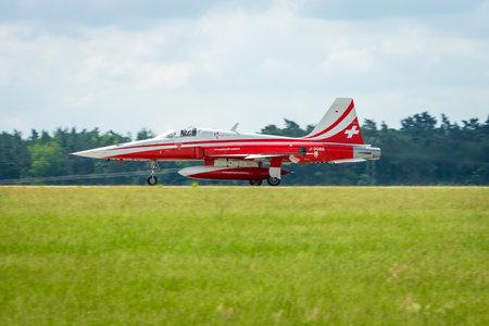 BERLIN, GERMANY - JUNI 02, 2016: Landing of jet Northrop F-5E Tiger II. The aerobatic team Patrouille Suisse. The pilot, Captain M.Duft. Exhibition ILA Berlin Air Show 2016 Editorial