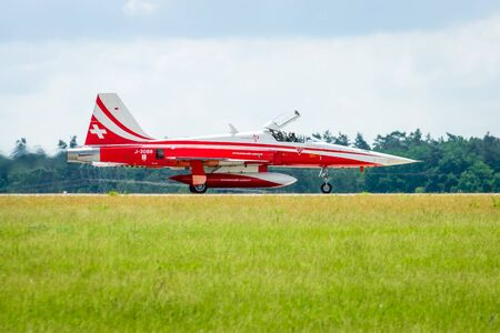 BERLIN, GERMANY - JUNI 02, 2016: Landing of jet Northrop F-5E Tiger II. The aerobatic team Patrouille Suisse. The pilot, Captain R.Freiburghaus. Exhibition ILA Berlin Air Show 2016