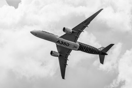 air demonstration: BERLIN, GERMANY - JUNE 02, 2016: Demonstration flight Airbus A350 XWB. Black and white. Exhibition ILA Berlin Air Show 2016