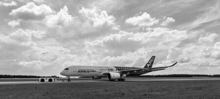 newest: BERLIN, GERMANY - JUNE 02, 2016: The newest Airbus A350 XWB at the airfield. Black and white. Exhibition ILA Berlin Air Show 2016