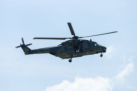 demonstrative: BERLIN, GERMANY - JUNE 03, 2016: Helicopter NH90 of the German Army. Demonstrative performance. Exhibition ILA Berlin Air Show 2016