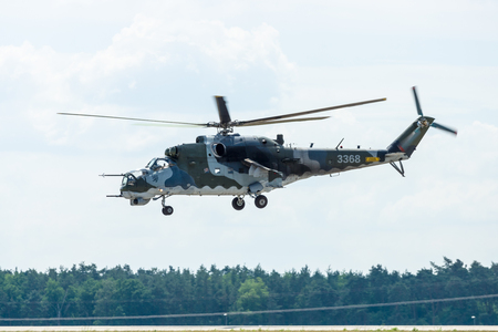 pilotage: BERLIN, GERMANY - JUNE 03, 2016: Attack helicopter Mil Mi-24 Hind. Czech Air Force. Exhibition ILA Berlin Air Show 2016