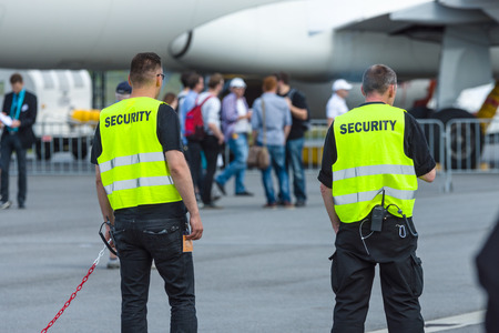 security staff: BERLIN, GERMANY - JUNE 03, 2016: Security staff at the airfield. Exhibition ILA Berlin Air Show 2016 Editorial