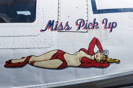 consolidated: BERLIN, GERMANY - JUNE 03, 2016: Figure in style Pin-up girl on board a maritime patrol and search-and-rescue seaplane Consolidated PBY Catalina (PBY-5A). Exhibition ILA Berlin Air Show 2016 Editorial