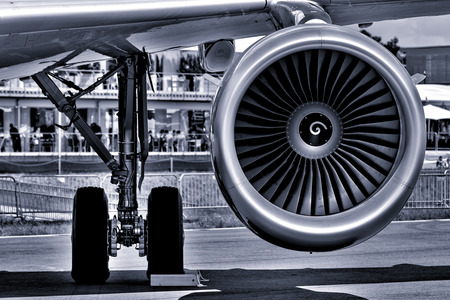 The landing gear and turbofan engine of passenger airliner. Black and white. Toning.