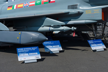 paveway: BERLIN, GERMANY - JUNE 03, 2016: Samples of the suspension arms, missiles and aerial bombs of multirole fighter Eurofighter Typhoon. Exhibition ILA Berlin Air Show 2016 Editorial