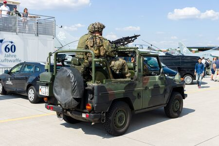 ensuring: BERLIN, GERMANY - JUNE 03, 2016: Soldiers and officers of the German army (Bundeswehr) in the car. Exhibition ILA Berlin Air Show 2016