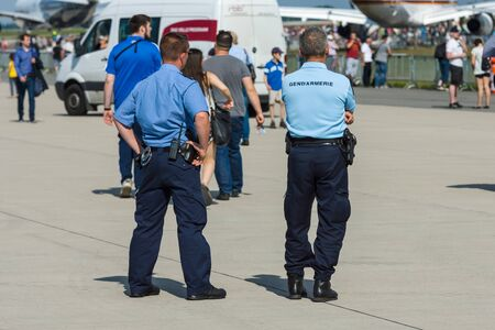 ensuring: BERLIN, GERMANY - JUNE 03, 2016: The representative of the police and gendarmerie on the airfield. Ensuring public order. Exhibition ILA Berlin Air Show 2016