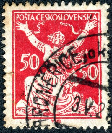 allegory: CZECHOSLOVAKIA - CIRCA 1920: Postage stamp printed in Czechoslovakia, shows the Allegory of Republic, Breaking Chains to Freedom, circa 1920 Editorial