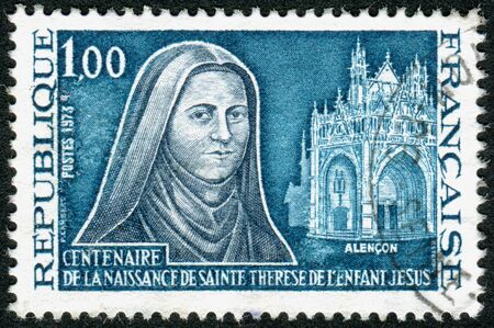 st mark: FRANCE- CIRCA 1973: Postage stamp printed in France, devoted to Centenary of the birth of St. Teresa of Lisieux, the Little Flower, Carmelite nun, circa 1973 Editorial