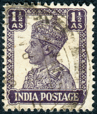 vi: INDIA - CIRCA 1942: A stamp printed in India, shows the King George VI, circa 1942