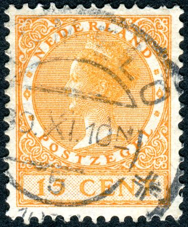 regnant: NETHERLANDS - CIRCA 1929: A stamp printed in the Netherlands, shows Wilhelmina of the Netherlands, circa 1929