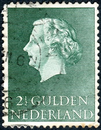 wilhelmina: NETHERLANDS - CIRCA 1955: Postage stamp printed in the Netherlands, shows Queen Juliana, circa 1955