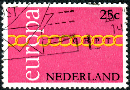 depicted: NETHERLANDS - CIRCA 1971: Postage stamp printed in the Netherlands, depicted Fraternity, Cooperation, Common Effort, circa 1971