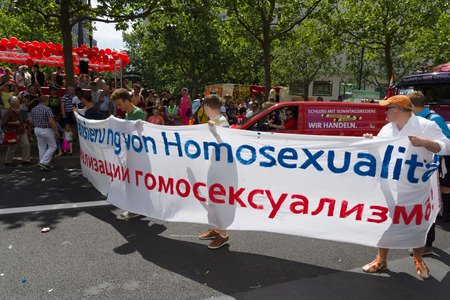 sex discrimination: BERLIN, GERMANY - JUNE 22, 2013: Christopher Street Day. Demonstration of support for gays and lesbians of Russia against homophobic of the Act passed by the State Duma of the Russian Federation.