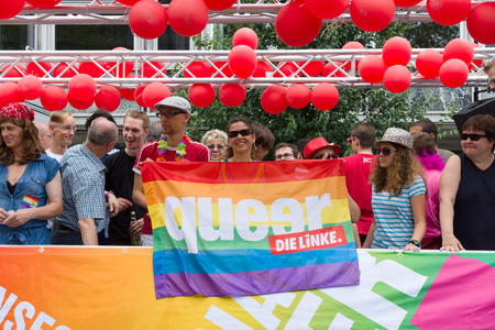 homophobia: BERLIN, GERMANY - JUNE 22, 2013: Christopher Street Day. The annual European LGBT celebration and demonstration for the rights of LGBT people. Participants of the political party Die Linke. Editorial