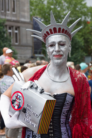 BERLIN, GERMANY - JUNE 22, 2013: Christopher Street Day. The annual European LGBT celebration and demonstration for the rights of LGBT people. Participant in the image of the Statue of Liberty.