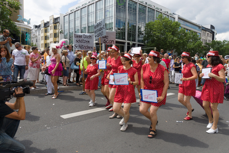 bisexual women: BERLIN, GERMANY - JUNE 22, 2013: Christopher Street Day. The annual European LGBT celebration and demonstration for the rights of LGBT people. Members of the Berliner Lesben Zensus.