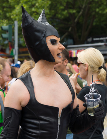 catwoman: BERLIN, GERMANY - JUNE 22, 2013: Christopher Street Day. The annual European LGBT celebration and demonstration for the rights of LGBT people. Editorial