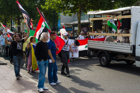 zionism: BERLIN, GERMANY - AUGUST 03, 2013: International Quds Day. A group of demonstrators supporting the policy of Syrian President Bashar Hafez al-Assad.